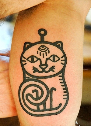 Would you so far as to get a cat tattoo? Via The Daily Tail